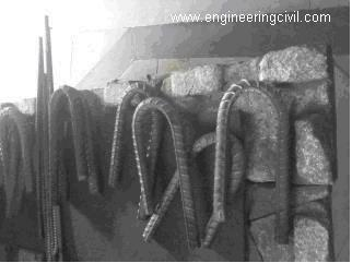 Bend pieces of rebar after test