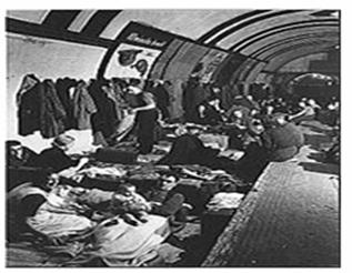 Londoners sheltering from The Blitz in a tube station