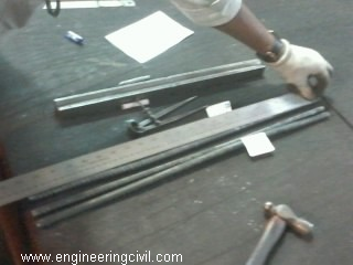Measuring length of rebar sample