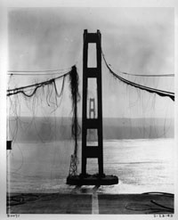 View of damaged cables and towers looking west, February 1943 WSDOT