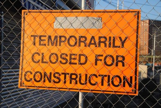 Signboard implying closed for construction work